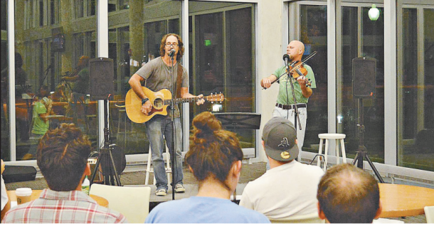 Billy Reeder (left) and Wren Whiteseven played at open mic night on Tuesday at Baz-Tech.