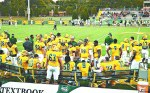 The Wonder Boys offense huddles around coaches during the 18-3 Family Day win on Oct. 4.