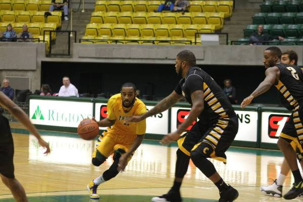 LAURA BEAN/THE ARKA TECH: Clarence Willard, pictured driving to the basket at a game at Tucker Coliseum earlier this season, made a buzzer beater to give Tech a win at 77-76 at Southeastern Oklahoma Saturday.