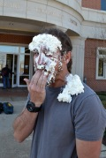 TOMMY MUMERT/THE ARKA TECH: Journalism professor Billy Reeder was pied in the face March 11 as part of the Journalists for Life Relay for Life team.